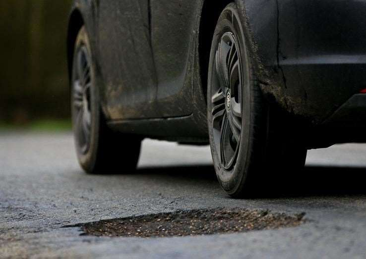 A pothole can cause damage to a car