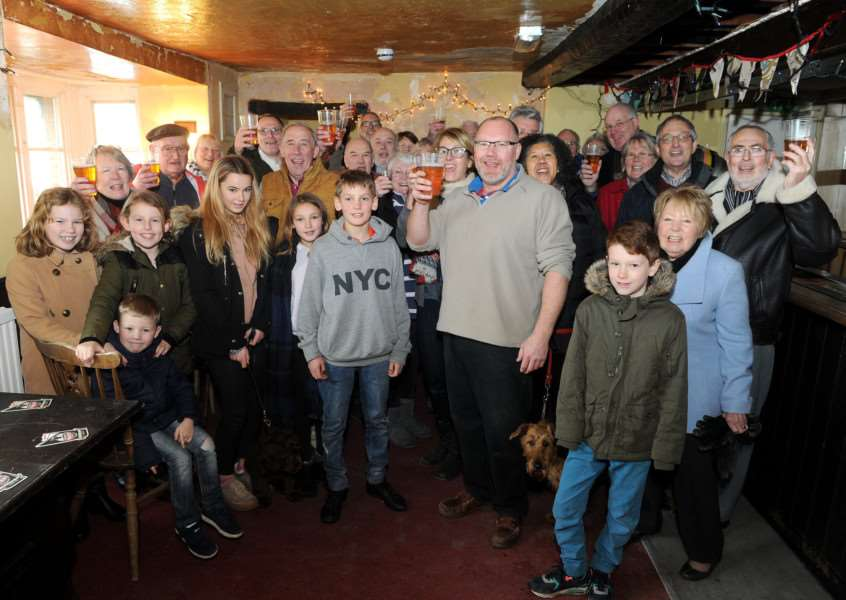Villagers toast the future of The Bull in Troston ANL-170301-154440009
