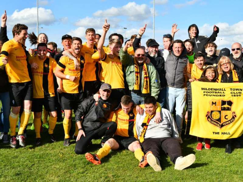 Mildenhall Town players celebrate winning the Thurlow Nunn League Premier Division with their travelling fans at Thetford Town Picture: Mark Bullimore