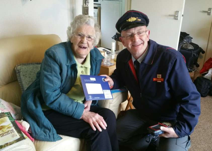 Lily Roberts receives her birthday message from The Queen from postman Stan. Picture: Janine O'Grady. ANL-161104-104936001