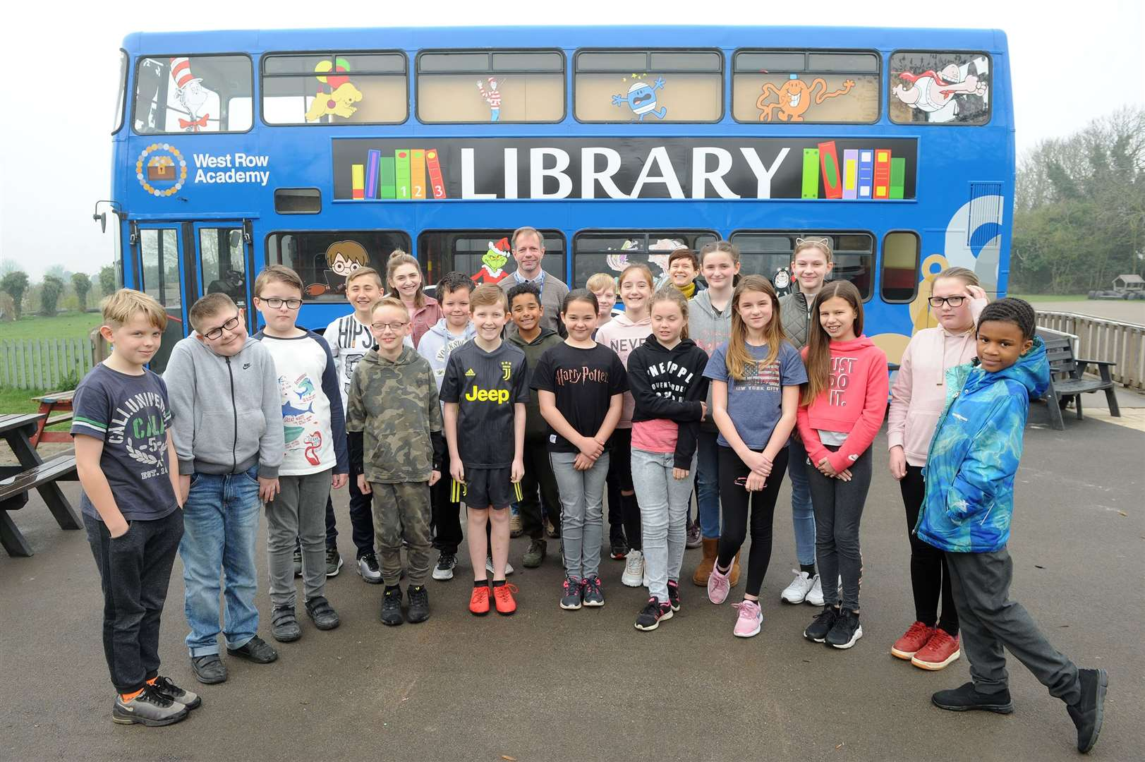 Pupils and staff at West Row Academy with the newly decorated library bus. Picture: Mecha Morton.