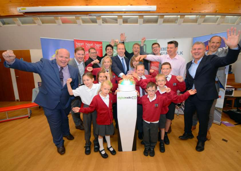 Adults (left to right): Sean Dunderdale, Lincs FM; Matt Deegan, MuxCo; Richard Lyon, Lincs FM; Sean Thorne, Fun Kids; Minister Matt Hancock MP; Adam Newstead, Heart Suffolk; Pip Whiteside, Ixworth CEVC Primary School; Chris Stevens, Chris Country; Luke Deal, BBC Suffolk; Ford Ennals, Digital Radio UK; Robert Hughes, Hughes Electricals. Children (left to right): Hannah Baker, Olivia Cole, Jessica Wood, Charlotte Read, Freya Lyddiat, Oliver Dowds, Alfie Rose, Ethan Doman ANL-160710-100645001