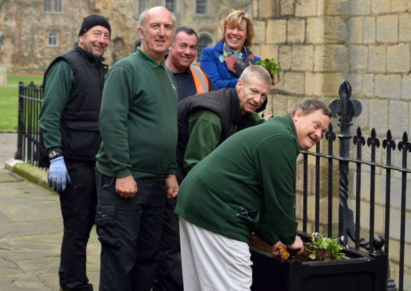 Melanie Lesser, Bury in Bloom co-ordinator with staff from St Eds BC and David Ryman, Therapeutic placement at Realise Futures planting in the newly refurbished planters at St Edmundsbury Cathedral Precinct. Photo by Sandy Miles. ANL-161216-115928001