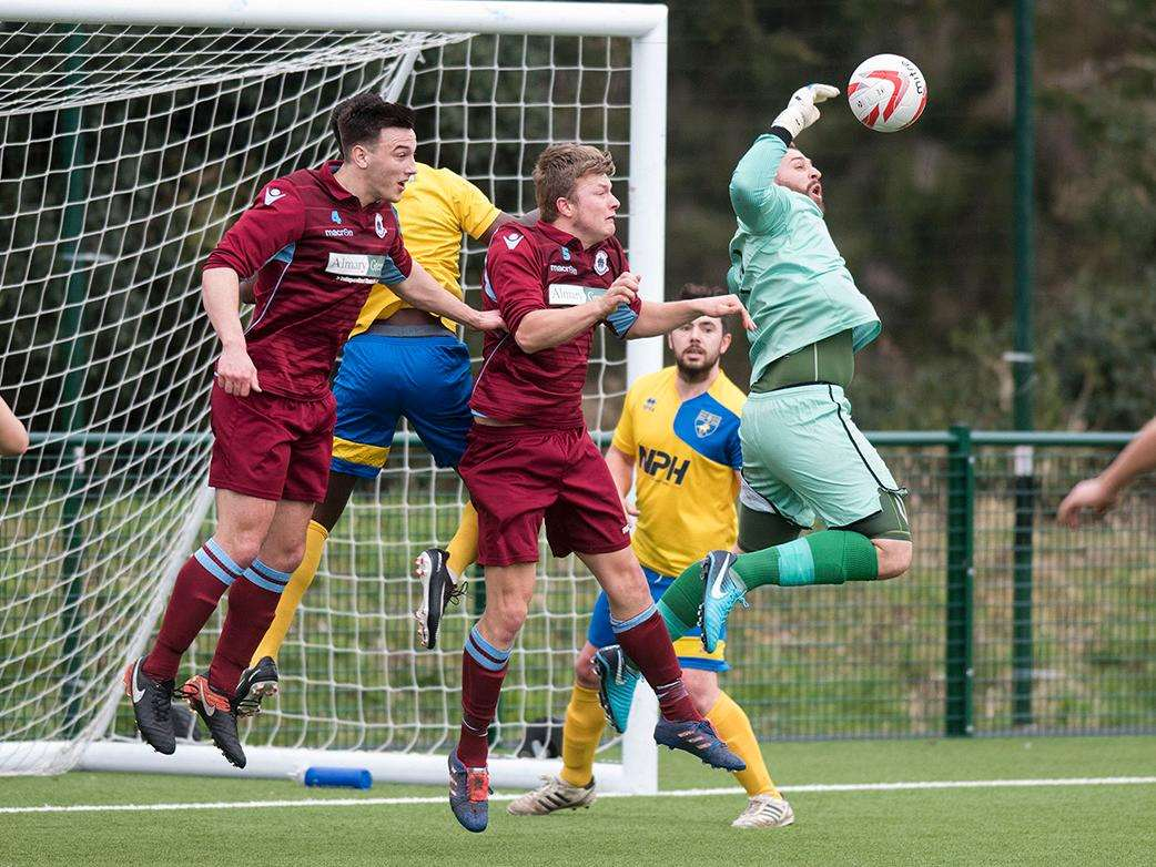 KEEPER'S BALL: Newmarket's Alex Archer tries to clear the danger. Picture: Mark Westley