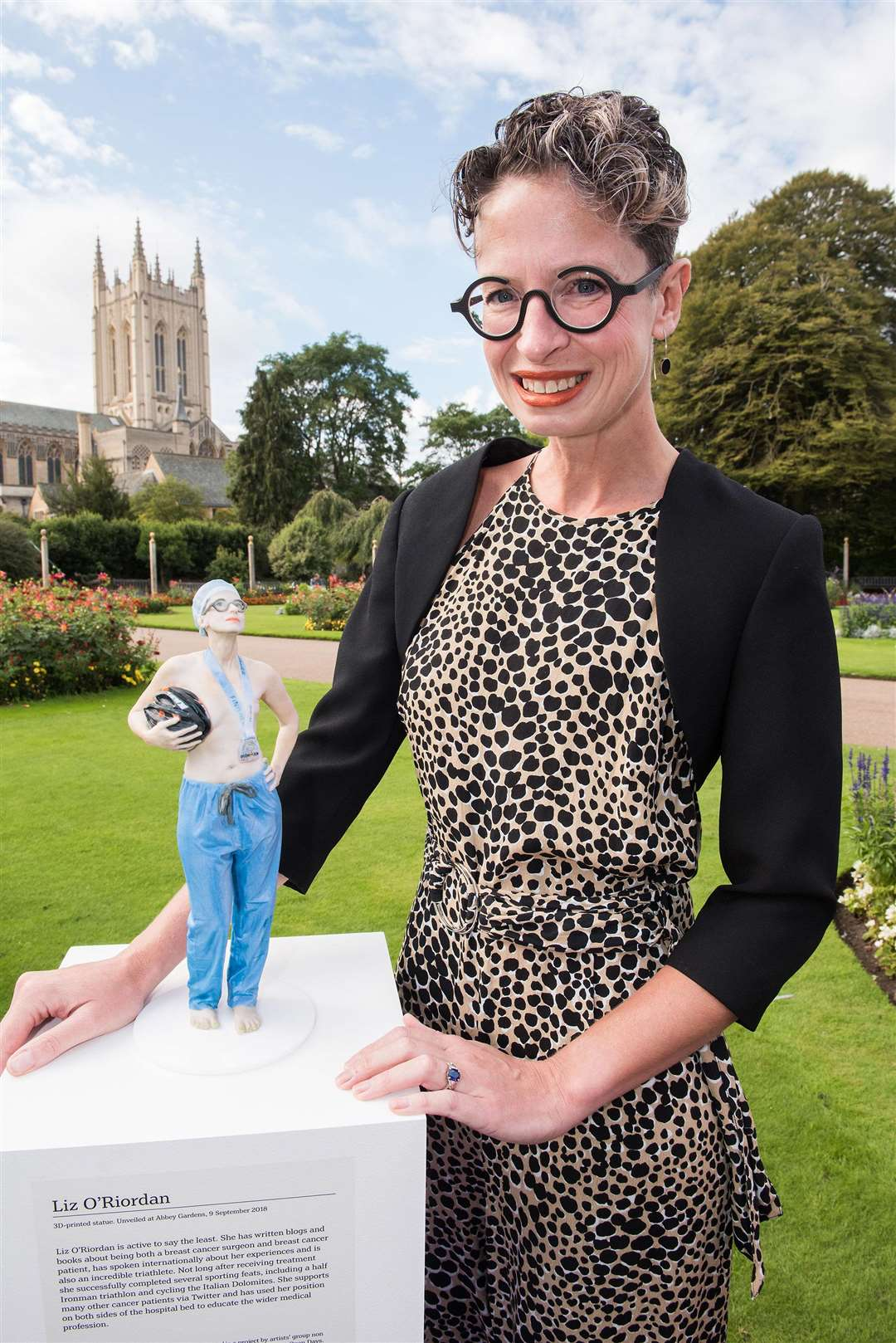Liz O'Riordan, a breast surgeon who had breast cancer, receives her life-like small statue in the Abbey gardens. Picture: Mark Westley.