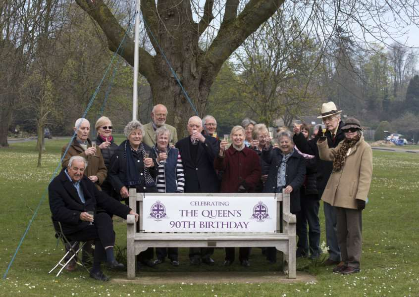 Villagers in Great Barton gather around the Jubilee Bench in Hall Park to toast the Queen's 90th birthday. 'Picture Mark Westley