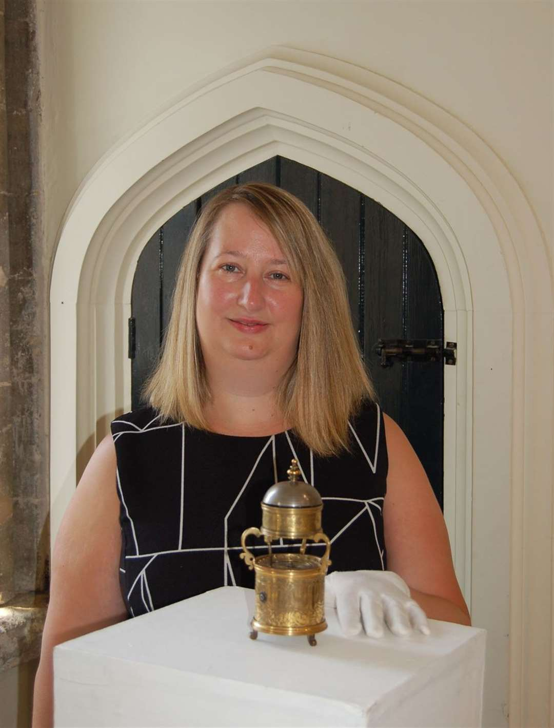 Cllr Joanna Rayner with the historic Drum Clock at Moyse's Hall Museum in Bury St Edmunds