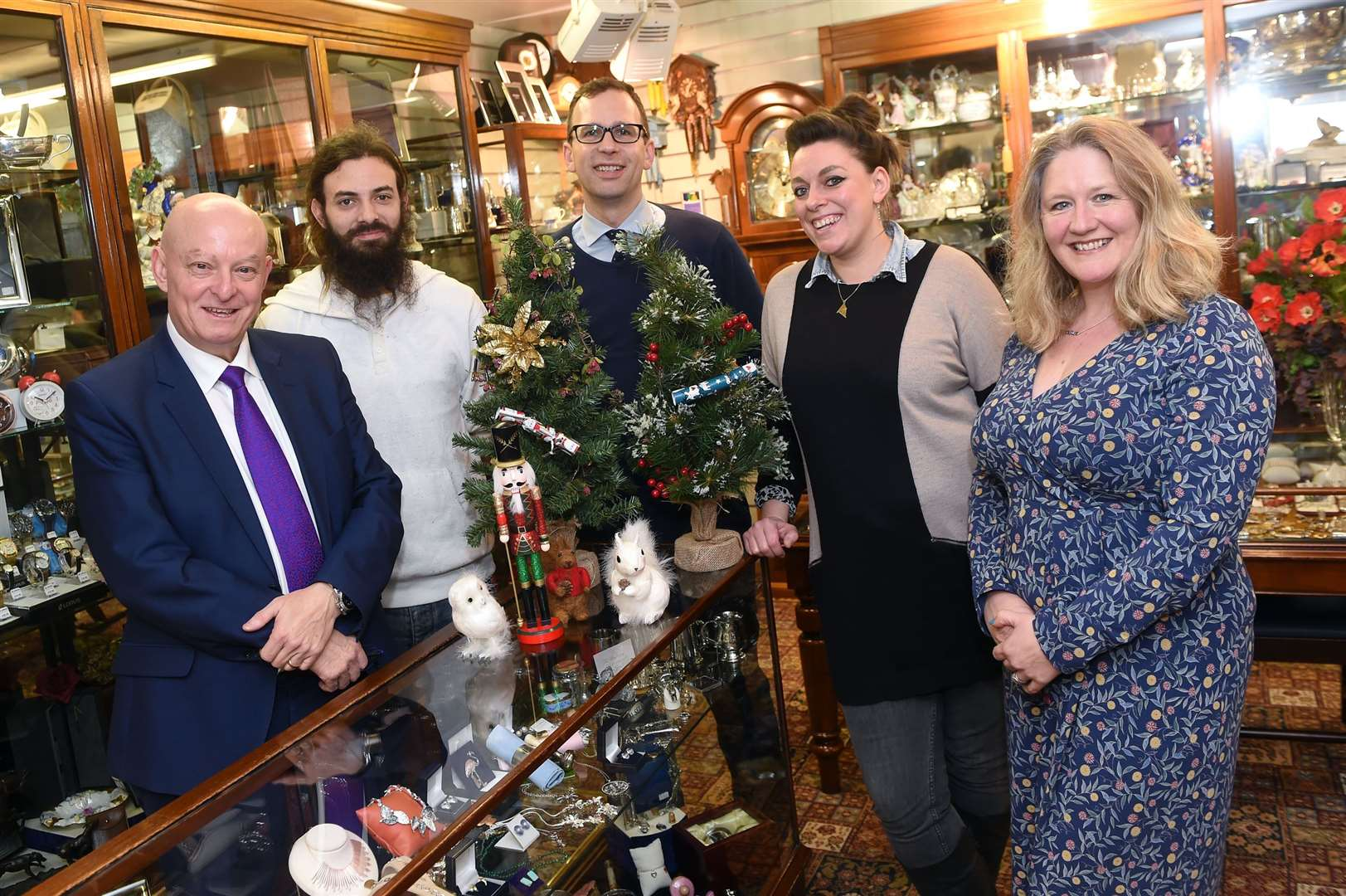Launch of the Christmas Window Competition in Sudbury ..Pictured: John Hume (Partner at Angelo Smith and Son) with Son Ben Hume, Richard Upton (Partner and Deputy Branch Manager At Waitress), Rachel Price (New Town Centre Manager) and Penny Wilby....PICTURE: Mecha Morton .... (22635295)