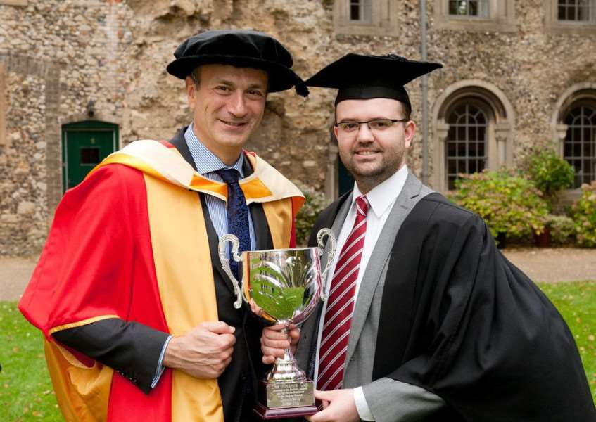 Accountant graduate Pete Richmond with West Suffolk College Principal Nikos Savvas, at the graduation ceremony