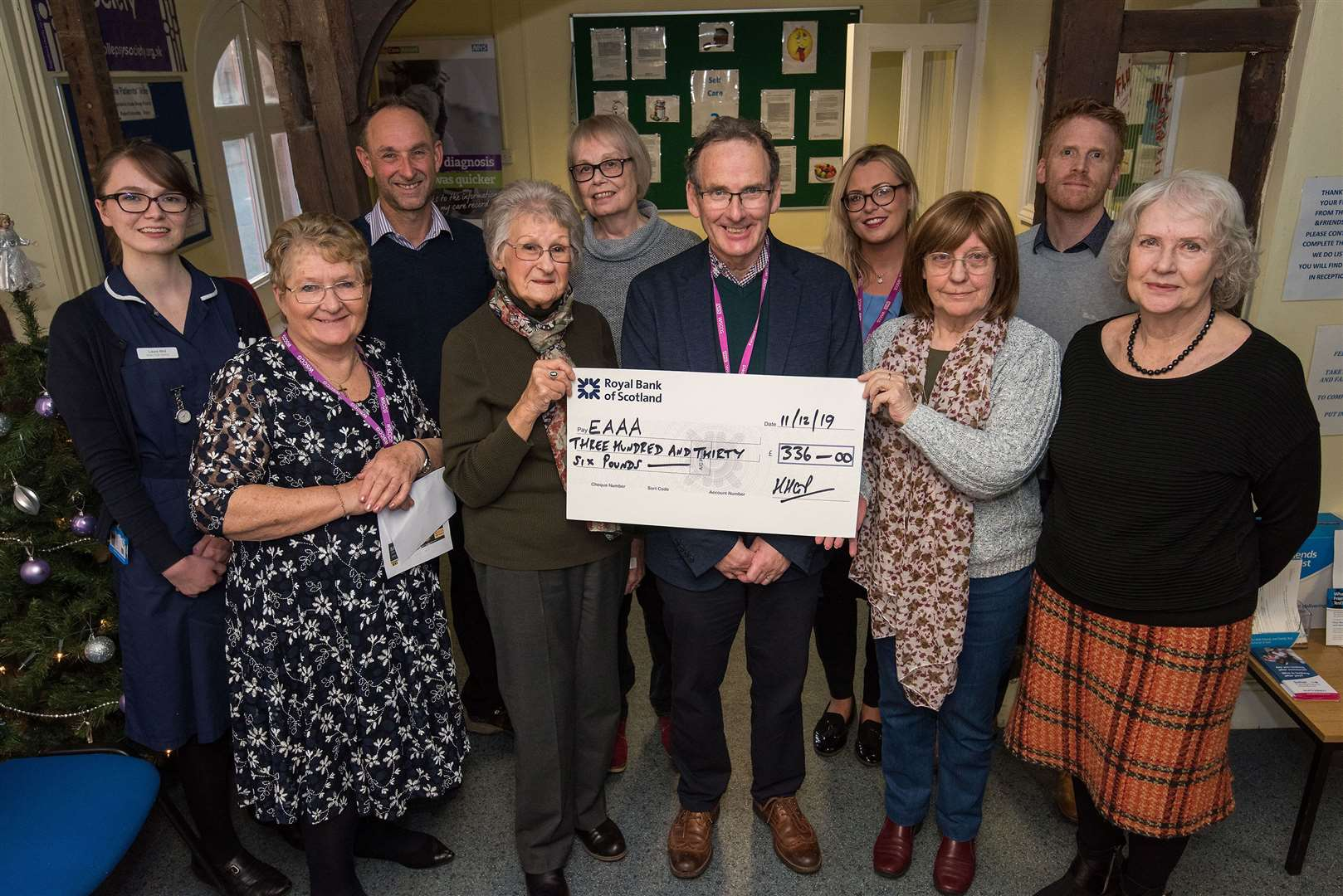 SUDBURY: Cheque presentation.Hardwicke House Group Practice, Stour Street, Sudbury. Sylvia Norton and Sylvia Banbridge PPG present cheque to Andy Read who is collecting on behalf of EAAA, pictured with Surgery friends , doctors and staff. Picture by Mark Westley. (24047241)