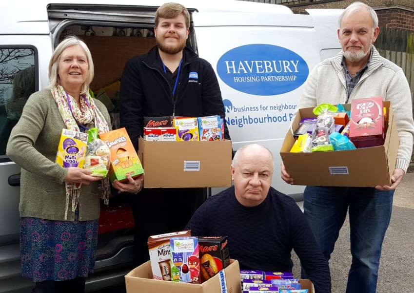 Reach Community Project's Ann Allen, Keith Barker and Richard Monksfield and Thomas Plumb from Havebury take stock of the Easter egg delivery. Picture by Henry Wilson