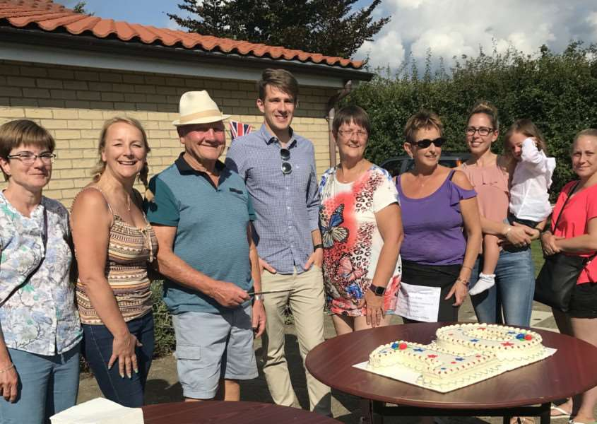 West Row Village Hall 10th birthday cake cuttin, from the left, Sue Peachey, Karen Gallagher, Nev Peachey (former chairman), Michael Peachey (current chairman), Sharon Phillips, Vicki Butler, Kate Wells and Kimberly Alcock