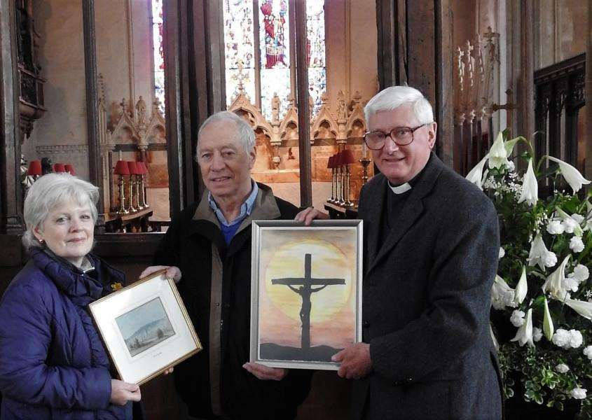 Pictured is the adult winner of Lavenham's Easter Art Trail, Brian Titus (centre). with his work, 'Jesus on the cross'.