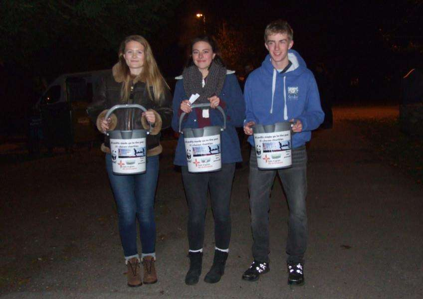 Stoke College students Freya Evans, Rosie Packford and Sam Newton with their collection buckets at the firework display ANL-160811-172848001