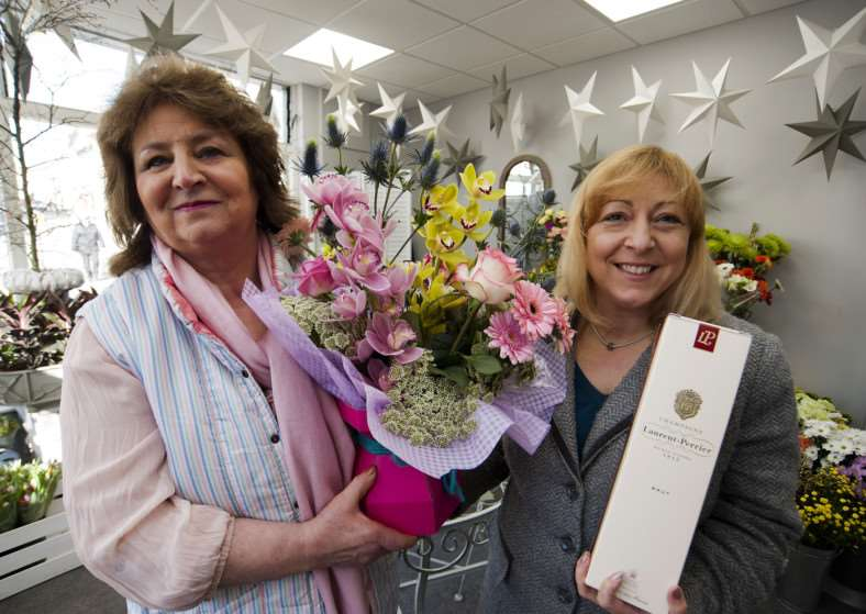 Mark Westley Photography'Stowmarket Edelweiss completes 45th aniversary flower chain owner Isabel Wilton hand out the final bouquet to Beverley Davies. ANL-150203-190513009