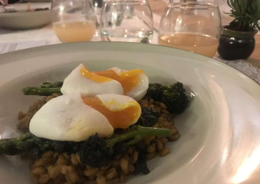 The Teal Dining Club's slow poached duck eggs with pearl barley and chard risotto and purple sprouting broccoli.