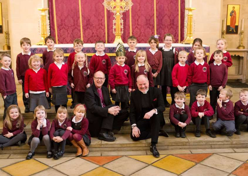 The Rev Canon Joe Hawes, Vicar of All Saints' Fulham, who will become the new Dean of St Edmundsbury this summer pictured with The Rt Rev Martin Seeley, Bishop of St Edmundsbury and Ipswich, and pupils visiting the cathedral in Bury St Edmunds for an RE lesson today. Picture: Keith Mindham.